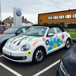 A special 70's theme for some of the cars on the forecourt at Benfield Volkswagen, Dumfries