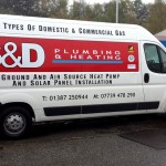 A business card on wheels with Car graphics by Border Signs & Graphics
