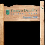 Timber welcome sign with routed text and logo - Dams to Darnley Country Park
