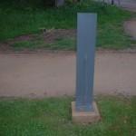 steel waymarker on concrete fitting