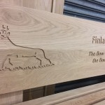 Detail of Oak bench with routed elements - Inverclyde Coastal Trail