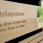 Oak bench Inverclyde Coastal Trail, with routed elements, and Multiguard® interpretive panels