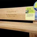 Oak bench with Multiguard® interpretive panels and routed elements - Inverclyde Coastal Trail