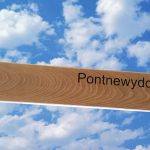 Oak fingerpost with routed text