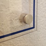Detail - aluminium stand-off for wall mounted signage
