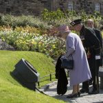 Routed timber memorial plaque on stone plinth - Revealed by HM the Queen