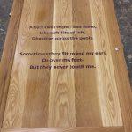 Poem engraved in oak door